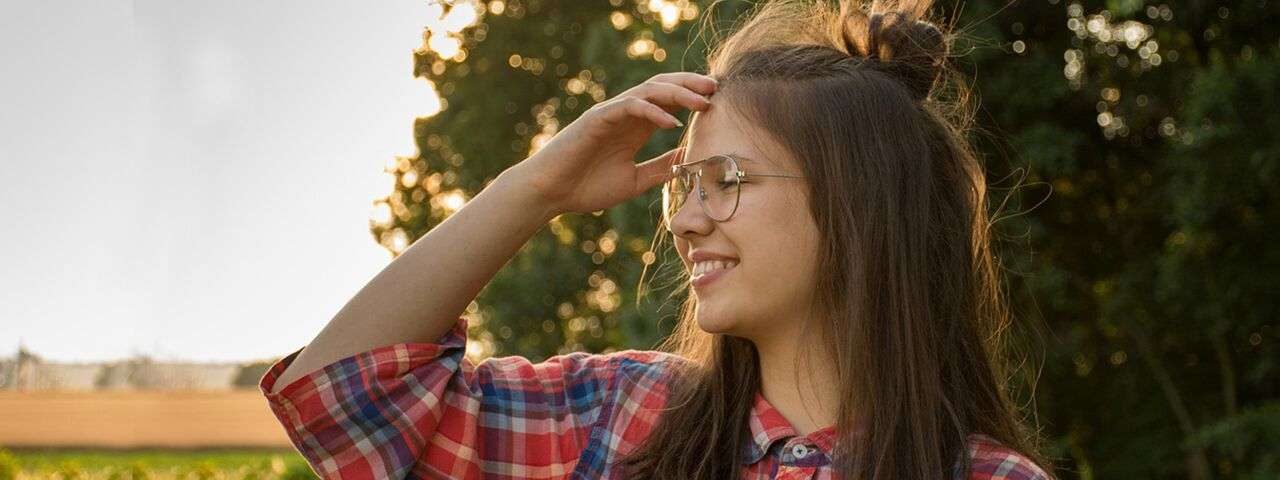 Girl20Smiling20Glasses20Outdoors201280x480_preview2.jpeg